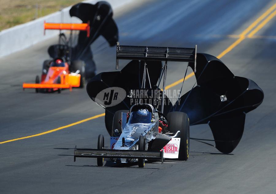 Jul. 30, 2011; Sonoma, CA, USA; NHRA top fuel dragster driver Bob Vandergriff Jr has a side panel peel away during qualifying for the Fram Autolite Nationals at Infineon Raceway. Mandatory Credit: Mark J. Rebilas-