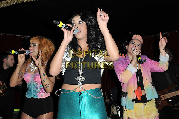Karls Anderson, Alexandra Buggs & Courtney Rumbold.Stooshe performing live in concert at Proud Cabaret, London, England..17th April 2012.on stage gig performance performing music half length white cropped jacket silver beads beaded black top blue spandex trousers corset jacket trousers pink blue orange singing spiked spikes shorts .CAP/MAR.© Martin Harris/Capital Pictures.
