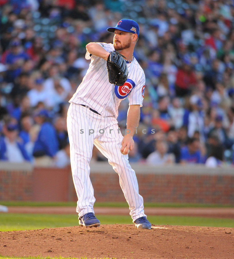 Chicago Cubs Travis Wood (37) during a game against the New York Mets on June 5, 2014 at Wrigley Field in Chicago, IL. The Cubs beat the Mets 7-4.
