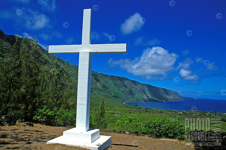 A large white cross overlooks the sea at the historic Kalaupapa Leprosy Settlement on the island of Molokai.