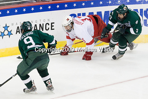 Chris Peluso (Bemidji State - 9), Trent Vogelhuber (Miami - 13), Ryan Adams (Bemidji State - 3) - The Miami University RedHawks defeated the Bemidji State University Beavers 4-1 in their 2009 Frozen Four Semi-Final match on Thursday, April 9, 2009 at the Verizon Center in Washington, DC.