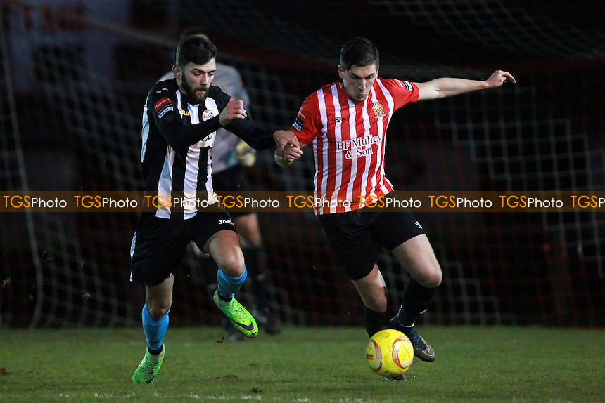 Jed Chouman of Hornchurch seeks to evade Tony Martin of Tilbury during AFC Hornchurch vs Tilbury, Ryman League Divison 1 North Football at Hornchurch Stadium, Upminster Bridge, UK on 26/01/2016