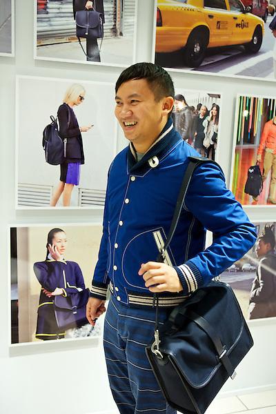 Tommy Ton wears his Club Monaco bag