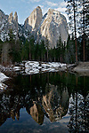 Winter scenes in Yosemite Valley located in the Yosemite National Park..The Cathedral Spires reflected in the Merced River.