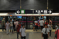 Passengers getting off at the station of Beijing Subway line 5, Beijing, China. Beijing Subway is a rapid transit rail network that serves the urban and suburban districts of Beijing municipality. It is the busiest subway in mainland China, and the second longest after the Shanghai Metro..30 Aug 2010