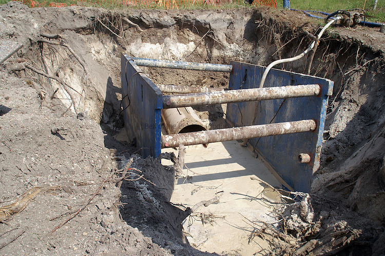 One of the serious problems with constructing a pipeline in Florida is the high water table.  Pumps have to be used to try to keep the water out of the trench.