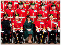 Catherine , The Duchess Of Cambridge presents shamrocks to the 1st Battalion Irish Guards at Mons Barracks , Aldershot. Catherine wore an elegant green dress coat by Emilia Wickstead with a 'Betty Boop'  Chocolate hat by Lock & with an Irish Guards brooch that belonged to the Queen Mother..Tel: 07515 876520.e mail: info@kisforkate.com