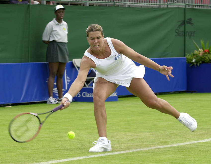 Photo. Richard Lane. .DFS Classic, Edgbaston, Birmingham. 13/6/2000.Jennifer Capriati returns on  her way to victory over Geat Britain's Lorna Woodroffe.