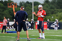 July 24, 2014 - Foxborough, Massachusetts, U.S.- New England Patriots quarterback Tom Brady (12) gestures to offensive coordinator Josh McDaniels during the New England Patriots training camp held at Gillette Stadium in Foxborough Mass.Eric Canha/CSM