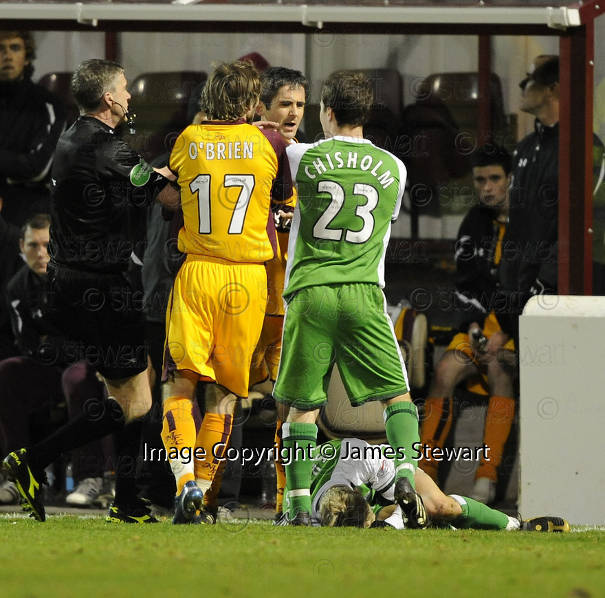 22/11/2008  Copyright Pic: James Stewart.File Name : sct_jspa22_motherwell_v_hibernian.KEITH LASLEY AND ROSS CHISHOLM CLASH AFTER LASLEY BRINGS DOWN DEAN SHIELS.James Stewart Photo Agency 19 Carronlea Drive, Falkirk. FK2 8DN      Vat Reg No. 607 6932 25.Studio      : +44 (0)1324 611191 .Mobile      : +44 (0)7721 416997.E-mail  :  jim@jspa.co.uk.If you require further information then contact Jim Stewart on any of the numbers above.........