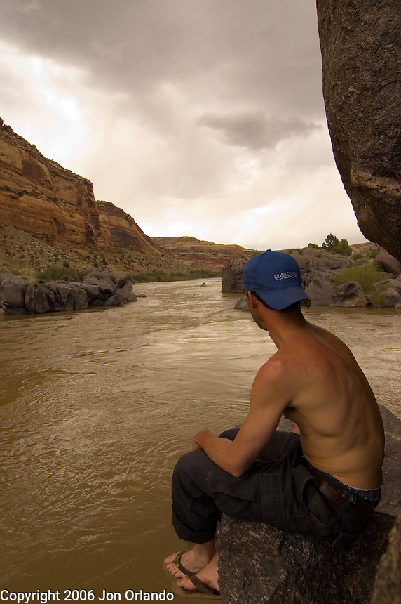 Dave Gentempo watches a storm roll in to Horsethief Canyon on the Colorado River in western Colorado.