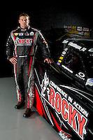 Dec. 5, 2012; Brownsburg, IN, USA; NHRA funny car driver Matt Hagan poses for a portrait during a photo shoot at the Don Schumacher Racing shop.  Mandatory Credit: Mark J. Rebilas-