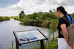 Visitor reads the interpretive board on the Anhinga Trial.
