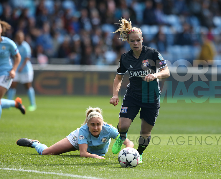 Steph Houghton of Manchester City women left on the ground by Eugenie Le Summer of Lyon Feminines during the Women's Champions League, Semi Final 1st leg match at the Academy Stadium, Manchester. Picture date 22nd April 2018. Picture credit should read: Simon Bellis/Sportimage