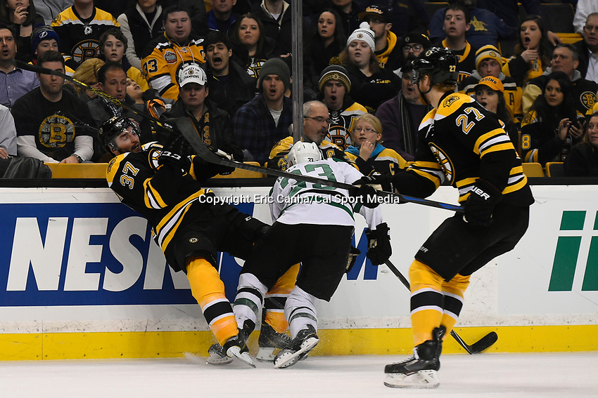 February 10, 2015 - Boston, Massachusetts, U.S. - Dallas Stars defenseman Alex Goligoski (33) and Boston Bruins center Patrice Bergeron (37) in game action during the NHL match between the Dallas Stars and the Boston Bruins held at TD Garden in Boston Massachusetts. Eric Canha/CSM