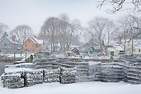 A grouping of Lobster traps at the Wickford Town Dock wait for better weather. In the background are some of the private homes at the end of Main Street.