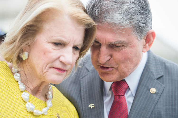 UNITED STATES - APRIL 26: Sen. Joe Manchin, D-W.Va., and Sen. Shelley Moore Capito, R-W.Va., attend a news conference at the House Triangle on April 26, 2017, with the United Mine Workers of America on the Miners Protection Act, which would address expiring health care and pension benefits. (Photo By Tom Williams/CQ Roll Call)
