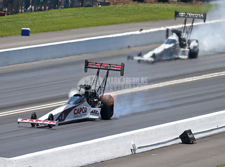 Jun 17, 2018; Bristol, TN, USA; NHRA top fuel driver Steve Torrence (left) against Antron Brown during the Thunder Valley Nationals at Bristol Dragway. Mandatory Credit: Mark J. Rebilas-USA TODAY Sports