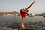 Boys enjoy the water late in the evening at Sultan Qaboos Port in Oman - National Geographic Traveler
