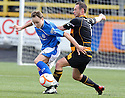 Stranraer's Sean Winter holds off Alloa's Darren Young.