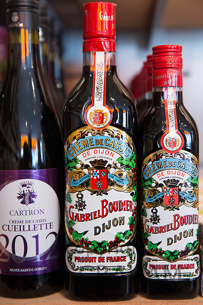 Local Creme de Cassis, a regional speciality, for sale in La Fabrique Bouchons in old town Dijon in Burgundy region, France