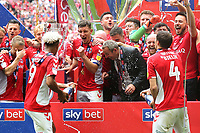 Charlton Manager, Lee Bowyer, covers his face after being sprayed with champagne by Lyle Taylor and Krystian Bielik as Charlton celebrate promotion to the Championship during Charlton Athletic vs Sunderland AFC, Sky Bet EFL League 1 Play-Off Final Football at Wembley Stadium on 26th May 2019