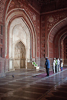 Agra, India.  Taj Mahal Mosque.  Worshippers at Mid-day Prayer.