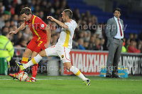 Cardiff City Stadium, Friday 11th Oct 2013. Andy King of Wales battles with Ostoja Stjepanovic of Macedonia during the Wales v Macedonia FIFA World Cup 2014 Qualifier match at Cardiff City Stadium, Cardiff, Friday 11th Oct 2014. All images are the copyright of Jeff Thomas Photography-07837 386244-www.jaypics.photoshelter.com