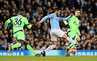 Manchester City's Ilkay Gundogan controls under pressure from FC Schalke 04&rsquo;s Breel Embolo<br /> <br /> Photographer Rich Linley/CameraSport<br /> <br /> UEFA Champions League Round of 16 Second Leg - Manchester City v FC Schalke 04 - Tuesday 12th March 2019 - The Etihad - Manchester<br />  <br /> World Copyright &copy; 2018 CameraSport. All rights reserved. 43 Linden Ave. Countesthorpe. Leicester. England. LE8 5PG - Tel: +44 (0) 116 277 4147 - admin@camerasport.com - www.camerasport.com