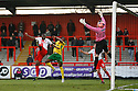 Francois Zoko of Stevenage heads past Dean Coleman of Stourbridge to score the opening goal<br />  - Stevenage v Stourbridge - FA Cup Round 2 - Lamex Stadium, Stevenage - 7th December, 2013<br />  © Kevin Coleman 2013
