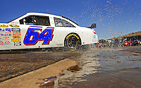 Apr 17, 2009; Avondale, AZ, USA; NASCAR Sprint Cup Series driver Todd Bodine drives through a puddle in the garage during practice for the Subway Fresh Fit 500 at Phoenix International Raceway. Mandatory Credit: Mark J. Rebilas-
