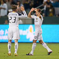 CARSON, CA – July 9, 2011: LA Galaxy midfielders David Beckham (23) and Landon Donovan (10) celebrate a goal during the match between LA Galaxy and Chicago Fire at the Home Depot Center in Carson, California. Final score LA Galaxy 2, Chicago Fire FC 1.