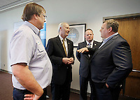 NWA Democrat-Gazette/DAVID GOTTSCHALK  Rick McWhirt (from left), president of Bekaert North America, Asa Hutchinson, governor of Arkansas, Greg Hines, mayor of Rogers and Matthew Taylor, chief executive officer of Bekaert, speak Wednesday, March 23, 2016, at the manufacturing plant in Rogers. The company announced a $32 million expansion and the creation of an additional 100 new jobs.