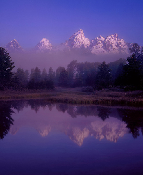 Morning fog and the Snake River, reflection of Grand Teton Peak, Grand Teton National Park, Jackson Hole, Wyoming, USA. John offers private photo tours in Grand Teton National Park and throughout Wyoming and Colorado. Year-round.