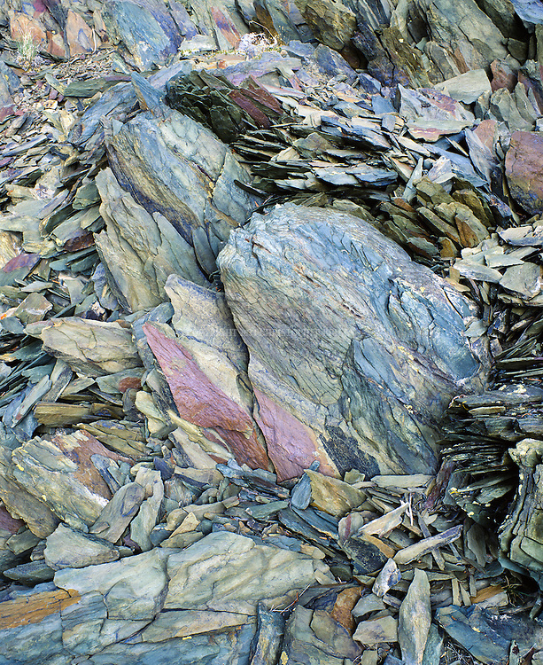 Sandstone-based shale outcroppings flake into amazing multi-colored patterns and textures. Photographed in the White Mountains, CA.