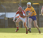 Daniel Kearney of Cork  in action against Conor Cleary of Clare during their Munster Hurling League game at Cusack Park. Photograph by John Kelly.