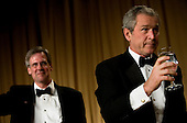 Washington, D.C. - April 21, 2007 - White House spokesperson Tony Snow (L) and United States President George W Bush participate in a toast at the White House Correspondents Association Dinner April 21, 2007 in Washington, DC.  Comedian Rich Little hosted and provided entertainment for Bush, White House reporters, their guests and celebrities.  .Credit: Brendan Smialowski - Pool via CNP