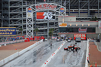 Apr. 3, 2009; Las Vegas, NV, USA: NHRA track crews work to dry the track during a rain delay in qualifying for the Summitracing.com Nationals at The Strip in Las Vegas. Mandatory Credit: Mark J. Rebilas-