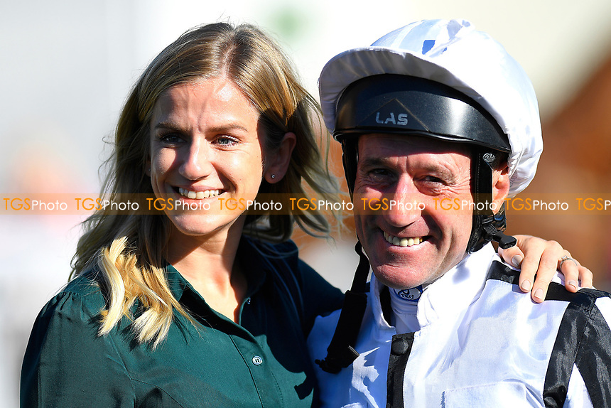 Jockey John Egan has his picture taken with a racegoer in the parade ring during Afternoon Racing at Salisbury Racecourse on 3rd October 2018