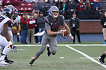 Tyler Hilinski, Washington State quarterback, looks for an open receiver down field during to the Cougars Pac-12 Conference demolition of the Arizona Wildcats, 69-7, on November 5, 2016, at Martin Stadium in Pullman, Washington.