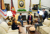 United States President Donald Trump (2nd-R) and First Lady Melania Trump (R) meet with Canadian Prime Minister Justin Trudeau (2nd-L) and his wife Sophie Grégoire in the Oval Office at the White House in Washington, D.C. on October 11, 2017. <br /> Credit: Kevin Dietsch / Pool via CNP