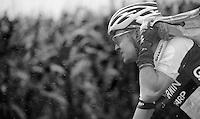 Nick Nuyens (BEL) struggling to get his rain jacket on<br /> <br /> Eneco Tour 2013<br /> stage 7: Tienen - Geraardsbergen<br /> 208km