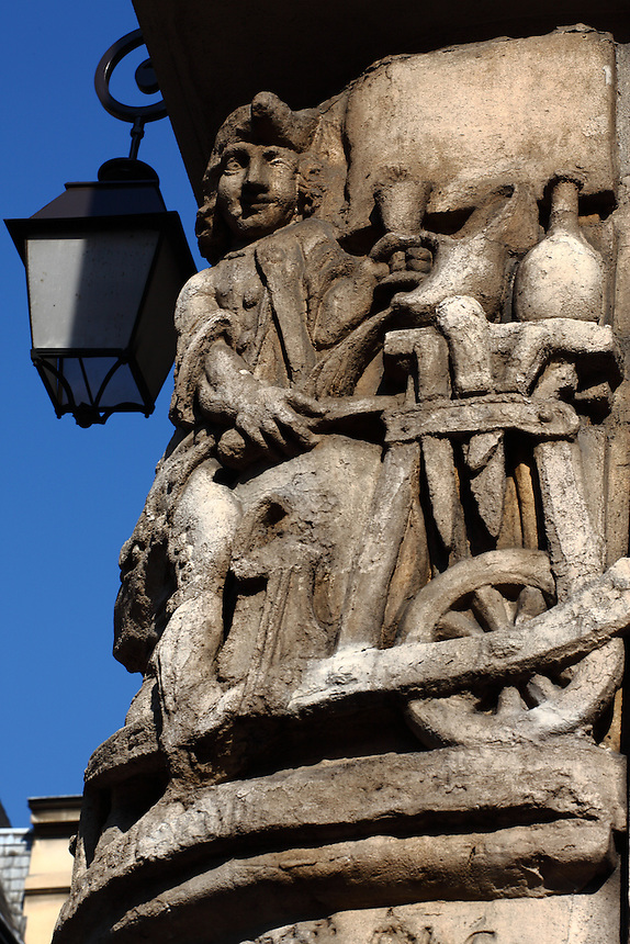 A view of a bas relief which is the copy of a sign of the XVIII century, with a street lamp, at the corner between rue de Fourcy and rue de Jouy, in the Marais, Paris. Digitally Improved Photo.