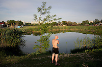 A man takes a break from fishing in a small pond to smoke a cigarette in Tiraspol, capital of Transnistria. Also known as Trans-Dniestr or Transdniestria, Transnistria, located mostly on a strip of land between the Dniester River and the eastern Moldovan border with Ukraine, broke away from Moldova in 1990 and although a de facto independent state, governed by the Pridnestrovian Moldavian Republic (PMR), is not recognised internationally.