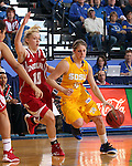 BROOKINGS, SD - MARCH 30:  Tara Heiser #12 from South Dakota State University drives against Taylor Agler #10 from Indiana University in the first half of their WNIT quarterfinal game Sunday afternoon at Frost Arena in Brookings. (Photo by Dave Eggen/Inertia)