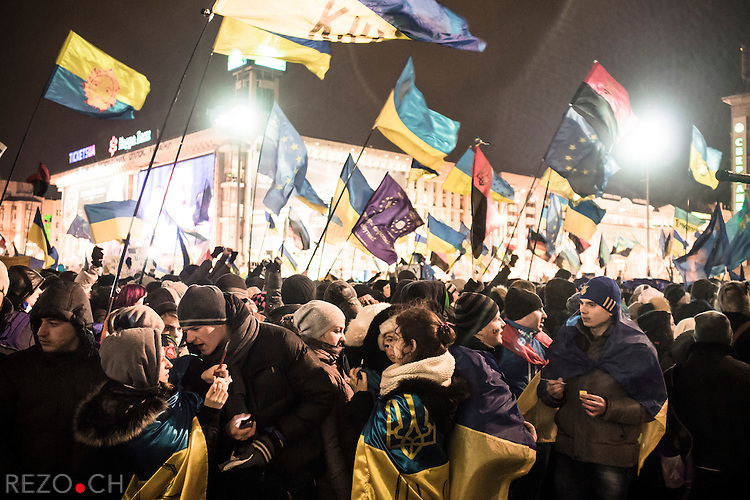 Kiev, Ukraine - 29 nov 2013: Students paint Ukrainian and european flags on their cheeks during the big rally organized after the end of Vilnius summit where Ukrainian president refused to sign an association treaty with European Union. Credit: Niels Ackermann / Rezo.ch