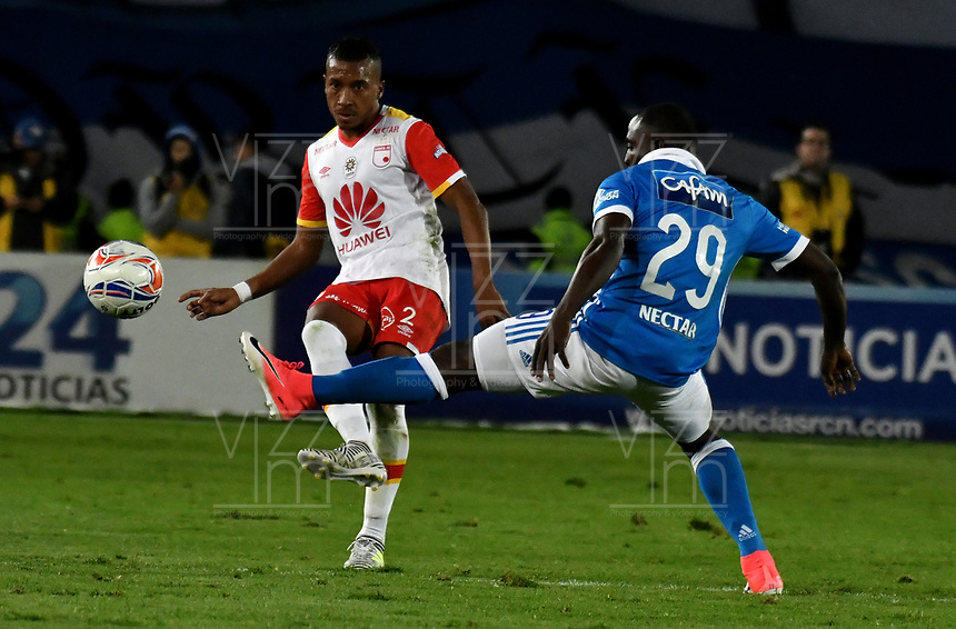 BOGOTA - COLOMBIA - 16 – 07 - 2017: Eliser Quiñones (Der.) jugador de Millonarios disputa el balón con Victor Giraldo (Izq.) jugador de Independiente Santa Fe, durante partido de la fecha 2 entre Millonarios y el Independiente Santa Fe, por la Liga Aguila II-2017, jugado en el estadio Nemesio Camacho El Campin de la ciudad de Bogota. Eliser Quiñones (R) player of Millonarios vies for the ball with Victor Giraldo (L) player of Independiente Santa Fe, during a match of the date 2nd between Millonarios and Independiente Santa Fe, for the Liga Aguila II-2017 played at the Nemesio Camacho El Campin Stadium in Bogota city, Photo: VizzorImage / Luis Ramirez / Staff.