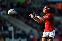 Latiume Fosita of Tonga receives the ball. Rugby World Cup Pool C match between Tonga and Namibia on September 29, 2015 at Sandy Park in Exeter, England. Photo by: Patrick Khachfe / Onside Images