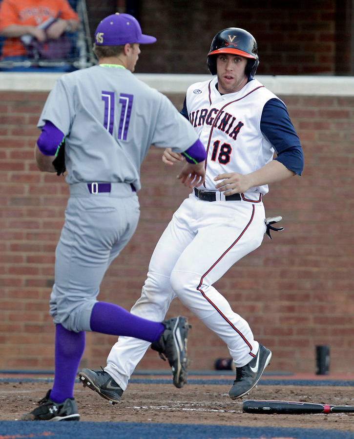 Virginia catcher Nate Irving (18) crosses home plate next to James Madison pitcher Ben Garner (11) during the game against James Madison University Tuesday in Charlottesville, VA.  Photo/The Daily Progress/Andrew Shurtleff