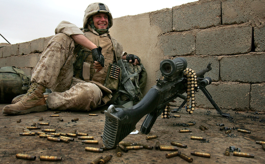 A machine-gunner from Golf Co. 2nd Battalion 1st Marines relaxes alongside his weapon during the third day of Operation Steel Curtain, an operation to clear Husaybah (a city on the Iraq-Syrian border) of insurgents on Mon. Nov. 7, 2005.